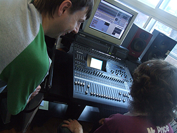 Recording in the studio at the main desk