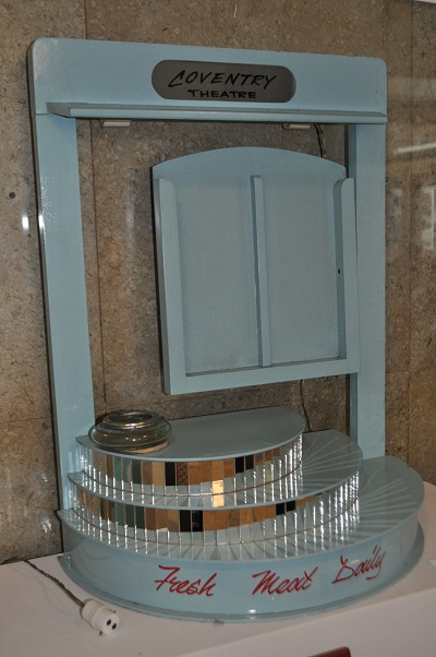 Light blue wooden leaflet stand with mirror tile trim and glass bowl ashtray