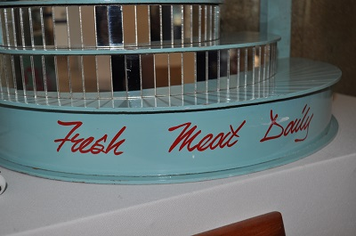 Painting sign 'Fresh Meat Daily'