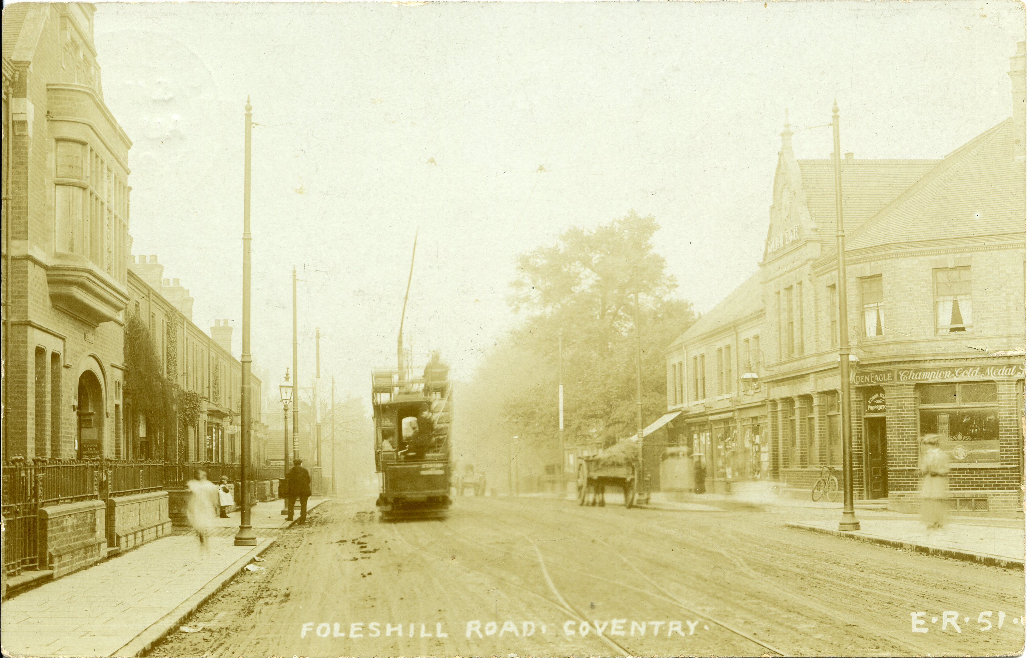 An old, sepia photo of the Foleshill Road with a tram