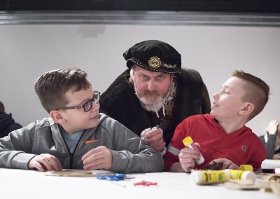 Henry VIII meets two younger visitors