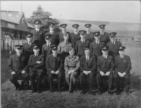 a black and white photo of people in uniform