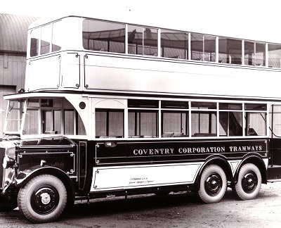 A black and white photo of an old bus with Coventry Corporation Tramways painted on the side