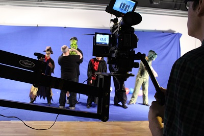 The actors being filming in monster costume against a screen