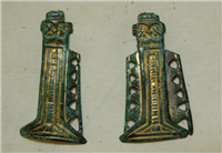 These Anglo Saxon gilded clothing fasteners date from around 550. Rich people wore fasteners like these on their sleeves.