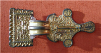 This is a gilded bronze Anglo Saxon brooch.