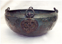 This is a hanging bowl dating from 500 to 800. It was used as a cremation vessel at Baginton Cemetery.