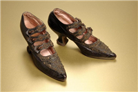 Kid leather shoes. These shoes are made from kid leather, which is from the skin of a young goat. They are lined with pink satin. In Victorian upper and middle class households a woman's role in life was to marry and produce children. Wealthy middle class