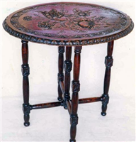 Folding table carved by Mary Ann's friend, Elma Stuart, 1872 to 1880.