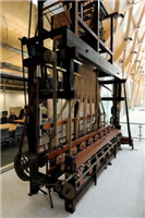This is a jacquard ribbon weaving loom made by Wilkinson's of Coventry in 1845 and used at Wm Franflin and Son's ribbon factory in Coventry until the 1960s. The jacquard loom was invented by Frenchman JM Jacquard in 1801.
