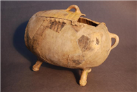 Apple Baker,1600s. This vessel was originally placed directly in the fire to bake apples. It was excavated in Bayley Lane in 1988. The fabric is Midlands yellow ware however there are also some green glaze patches which dripped on to it from other pottery